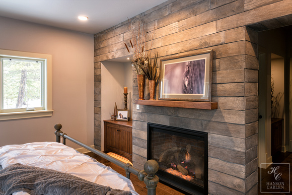 fireplace with barn wood surround