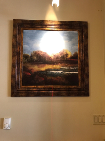 Use a laser level to hang photo
