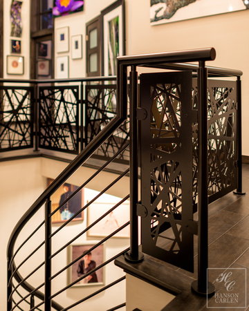 Helix stair with custom iron railing